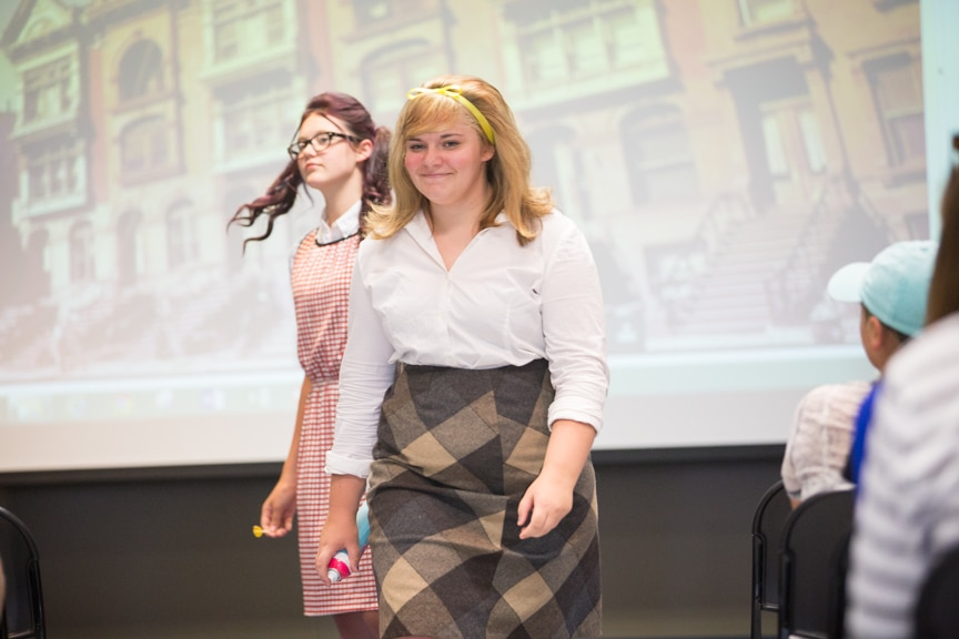 Models dressed in retro clothing walk down runway at Moraine Park fashion show