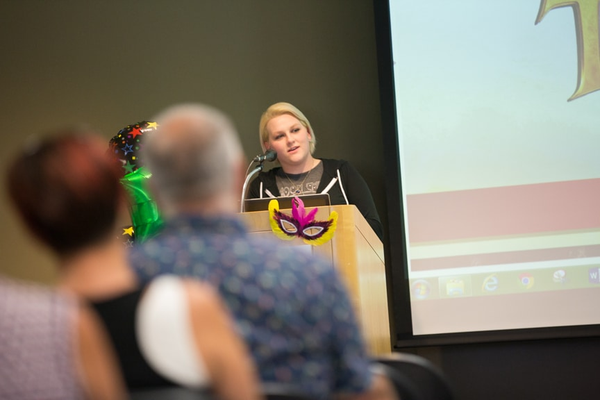 Cosmetology student talks at podium during Moraine Park fashion show
