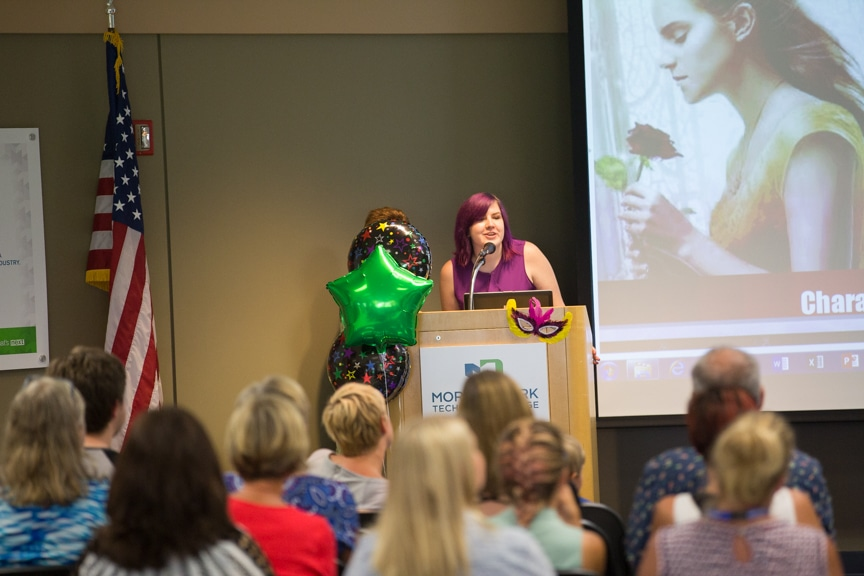 Student speaks at podium during Moraine Park fashion show