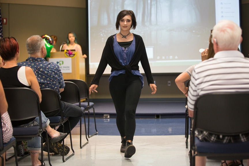 Model in black and blue outfit walks down runway at Moraine Park fashion show