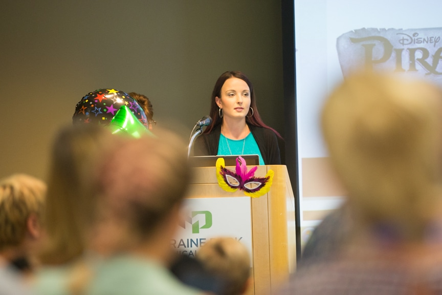 Student speaks from podium at Moraine Park fashion show