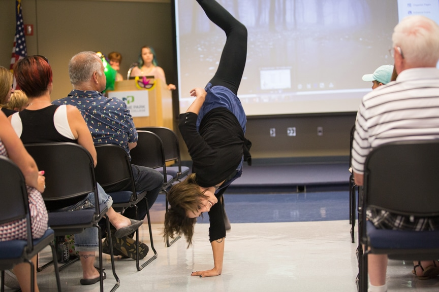 Model does cartwheel down runway at Moraine Park summer fashion show