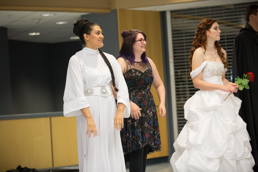 Models from Moraine Park cosmetology fashion show watch other participants