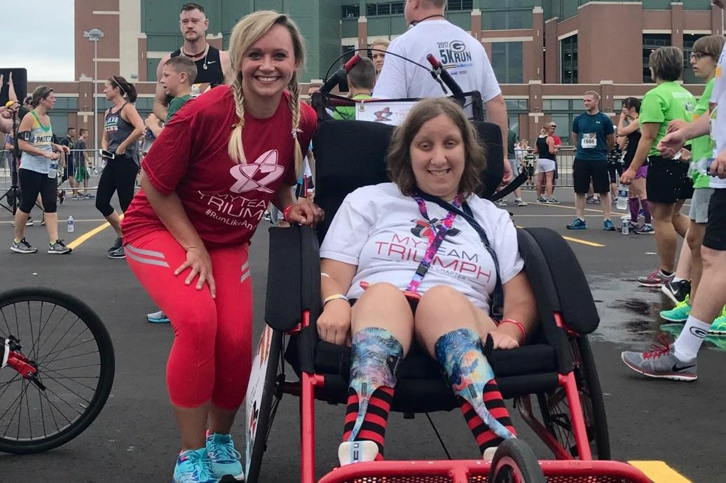 Hannah Hillesheim, Instructional Technology Specialist at Moraine Park, smiles with athlete from TEAM TRIUMPH