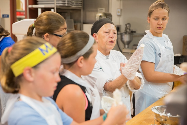 Instructor showcases proper icing techniques during culinary activity at Moraine Park Tech Knowledge College