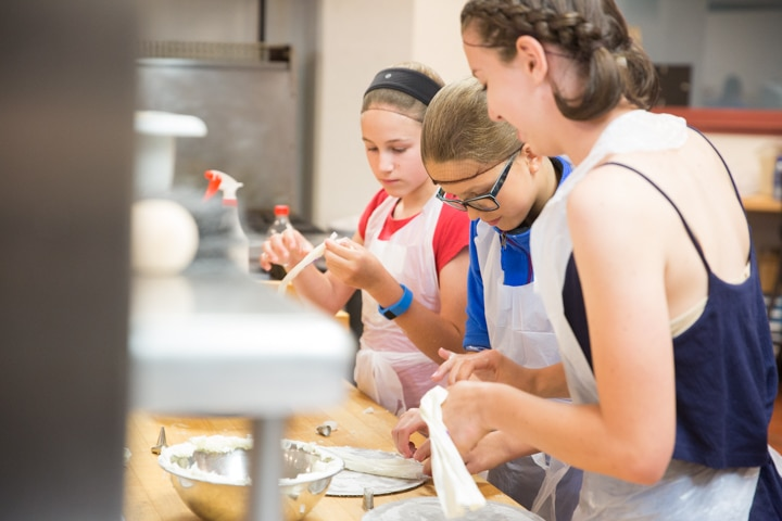 Girls work in kitchen during culinary activity at Moraine Park Tech Knowledge College