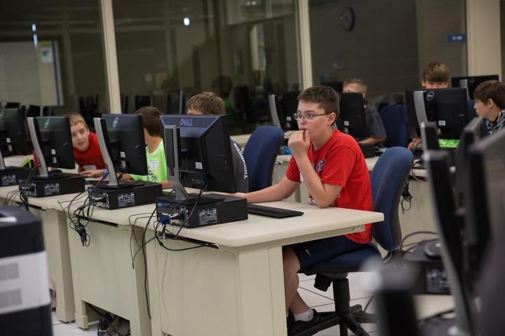 Boys work in computer lab at Moraine Park TKC summer camp