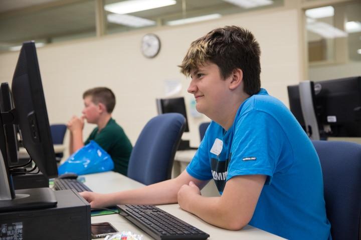 Boys work in computer lab at Moraine Park TKC