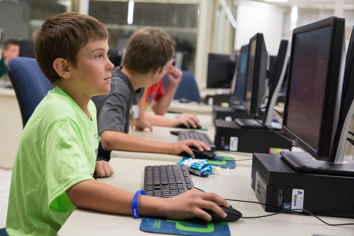 Boy work at computer during Moraine Park Tech Knowledge College
