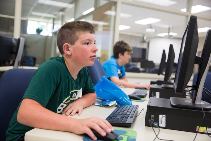 Boys work at computers during Moraine Park Tech Knowledge College