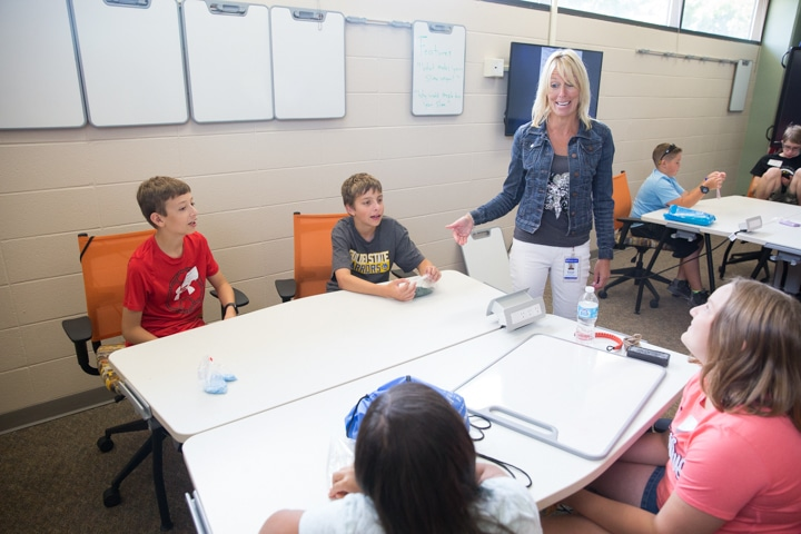Instructor Brenda Schaefer talks to students during business management activity at Moraine Park TKC summer camp
