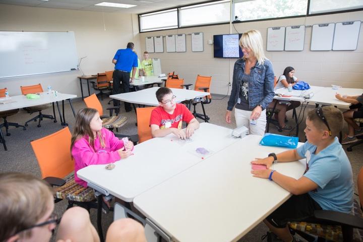 Instructor Brenda Schaefer talks to students during business management activity at Moraine Park TKC summer camp