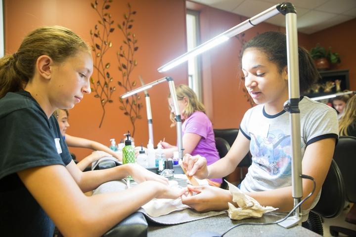 Girls enjoy manicures at Moraine Park Tech Knowledge College