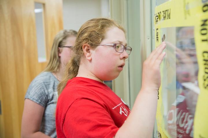 Girl uses tape to lift fingerprints from window at Moraine Park TKC