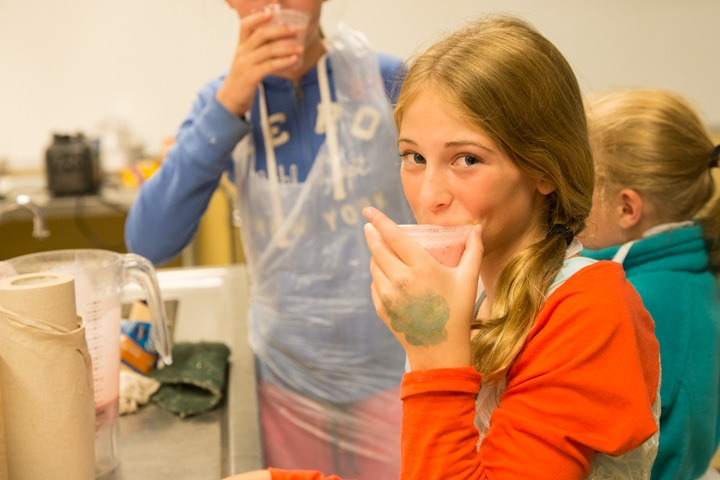 Girl takes sip of smoothie in Moraine Park kitchen