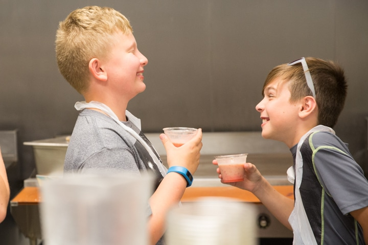 Two boys laugh while holding smoothies at Moraine Park TKC