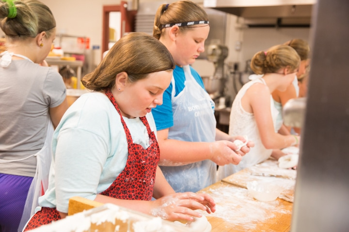 Girl presses dough on counter at Moraine Park Tech Knowledge College