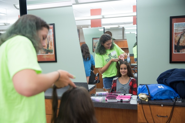 Two girls enjoy TKC summer camp cosmetology activity