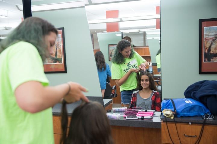 Two girls enjoy TKC summer camp cosmetology activity