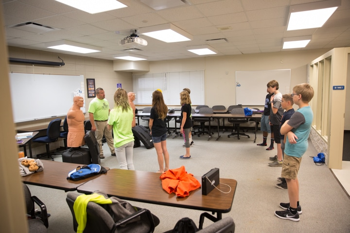 Students listen to corrections instructor at Moraine Park TKC event