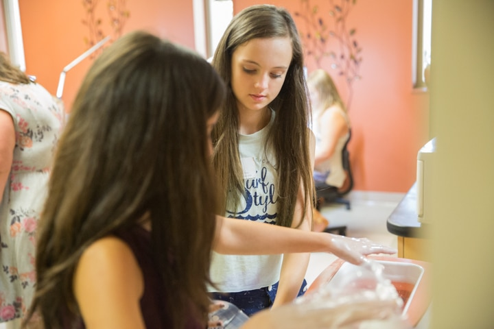 Girls prepare for manicure activity at Moraine Park TKC summer camp