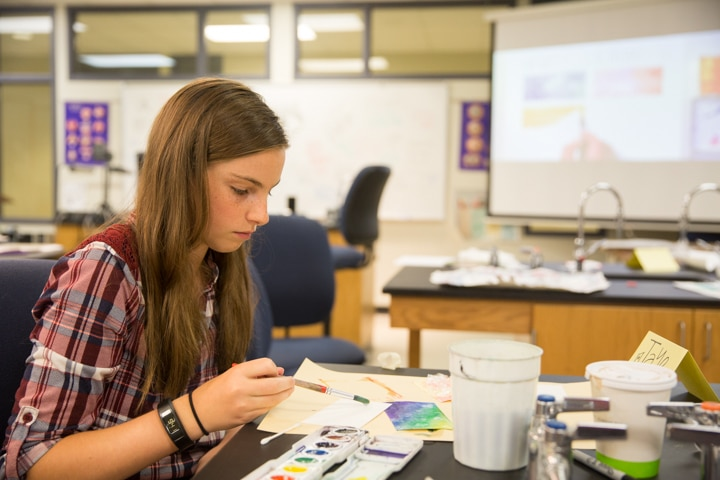 Girl works on painting activity during Moraine Park Tech Knowledge College