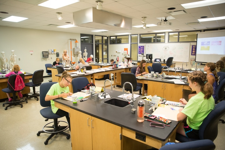 Classroom of students work on art projects at Moraine Park TKC event