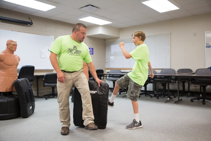 Boy kicks pad during criminal justice use of force activity at Moraine Park