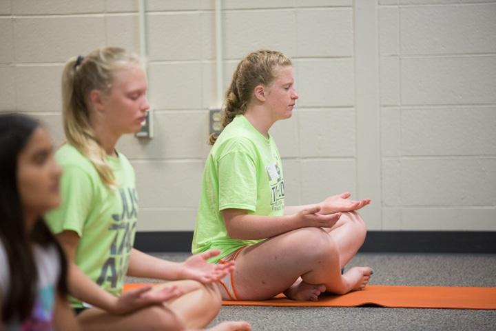 Girl practices yoga pose at Moraine Park TKC