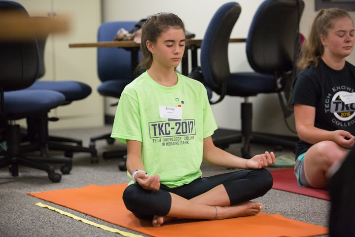 Girl practices yoga pose at Moraine Park TKC