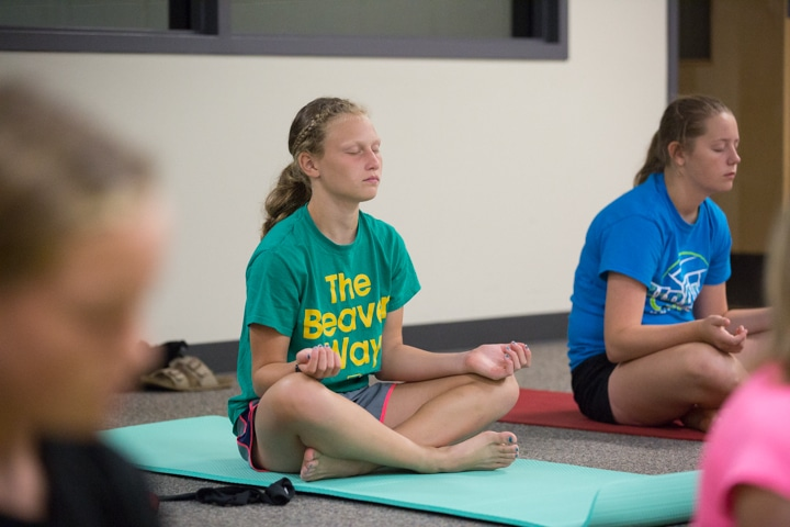 Girls practice yoga techniques at Moraine Park TKC in Fond du Lac