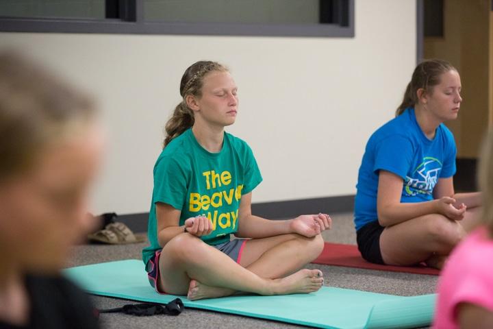 Girls practice yoga techniques at Moraine Park TKC in Fond du Lac