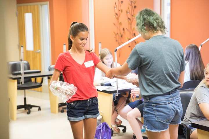 Girls enjoy manicure activity at Moraine Park TKC summer camp