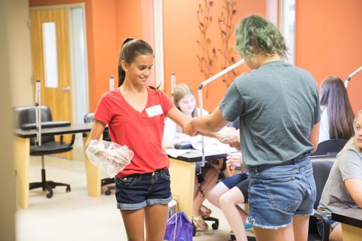 Girls enjoy manicure activity at Moraine Park TKC summer camp