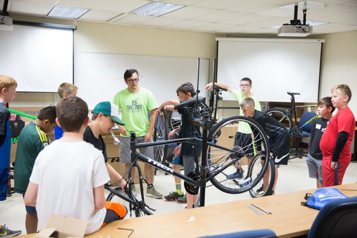 Students examine bike tires at Moraine Park TKC in Fond du Lac