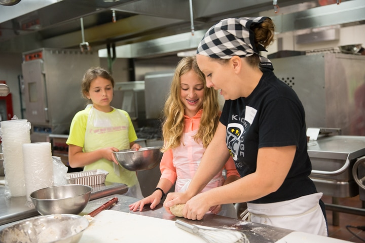 Girls enjoy culinary activity in Moraine Park kitchen in Fond du Lac