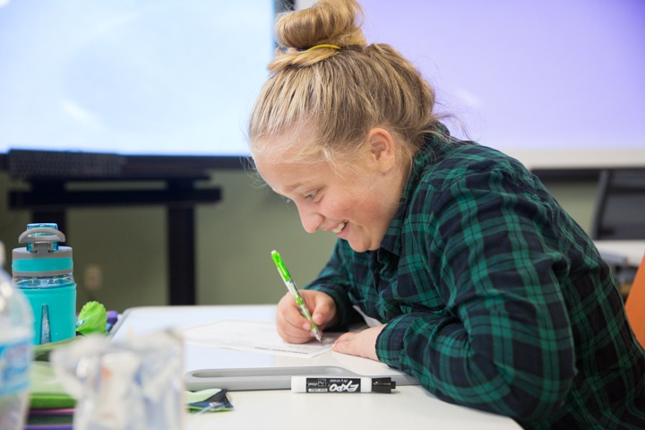 Girl smiles during business planning session at Moraine Park TKC event