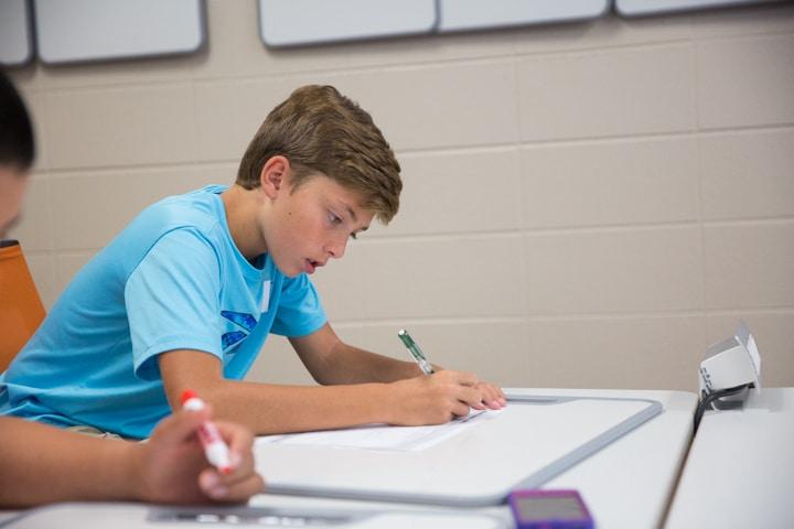 Boy draws out business plan at Moraine Park TKC event