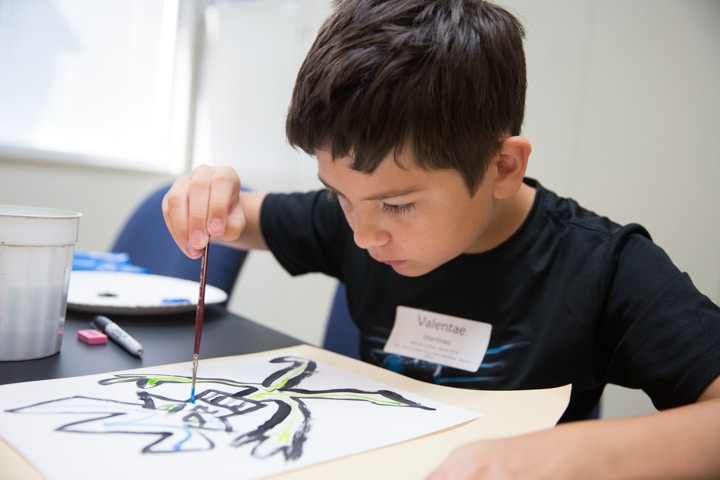 Boy works on painting project at Moraine Park Tech Knowledge College