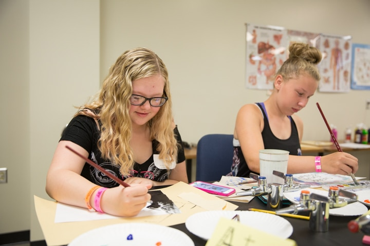 Girls work on painting projects at MPTC Tech Knowledge College