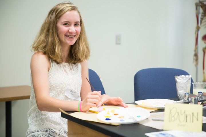 Girl works on painting project during MPTC Tech Knowledge College summer camp