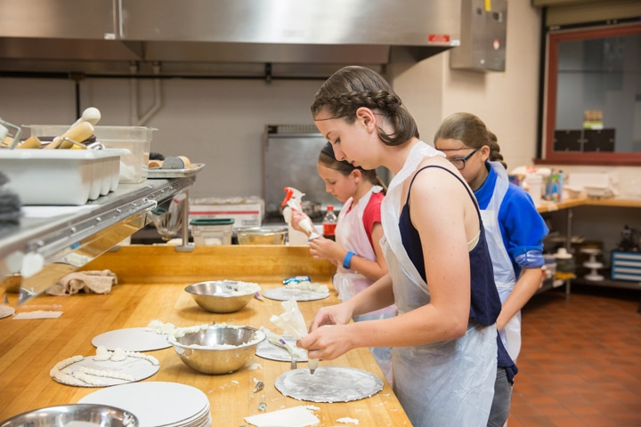 Girls work on icing project during Moraine Park TKC