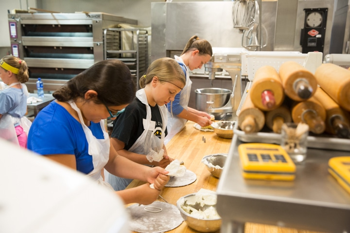 Girls work on icing project during Moraine Park summer camp