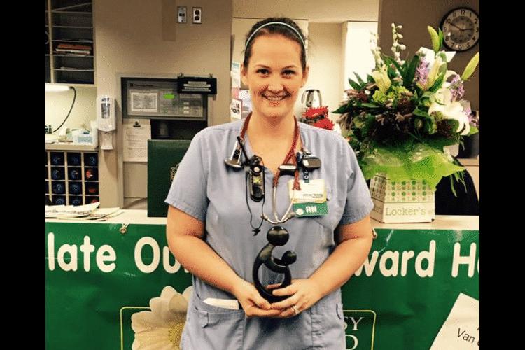 woman with nursing award