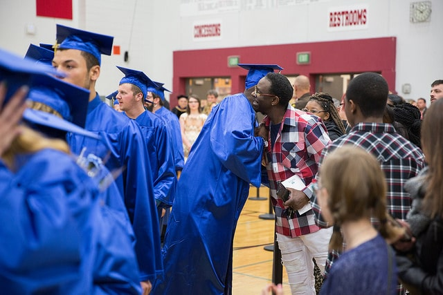 male graduate receiving hug