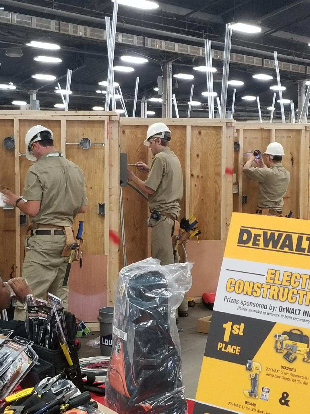 Students using screw driver competition at National Skills USA