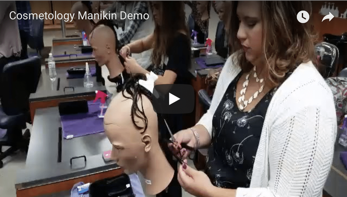 Screenshot of video thumbnail featuring cosmetology students cutting hair