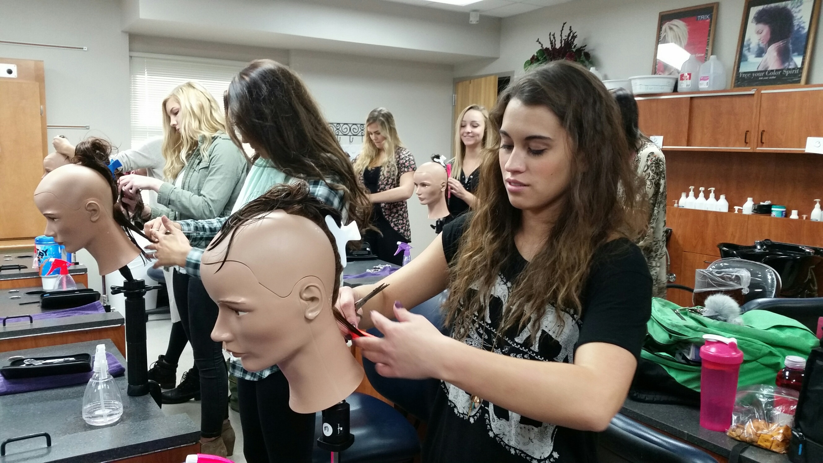 female students working on mannequins