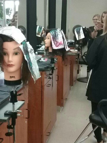 MPTC - Cosmetology Matrix Color Melting training - manikin heads with color on hair