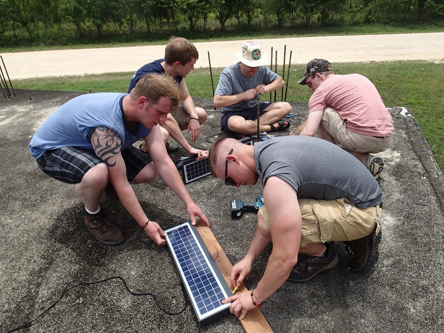 students work on solar panels